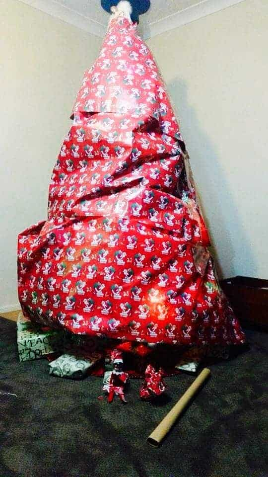 Elf on the shelf wrapped christmas tre