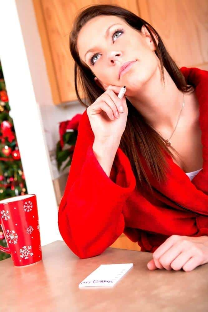 Woman planning her christmas to do list