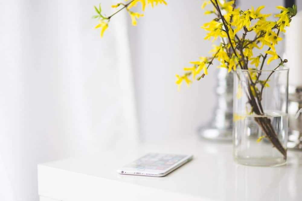 Vase on table with phone minimalist home