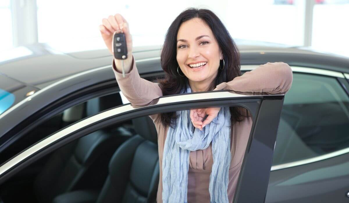 Woman with keys to new car
