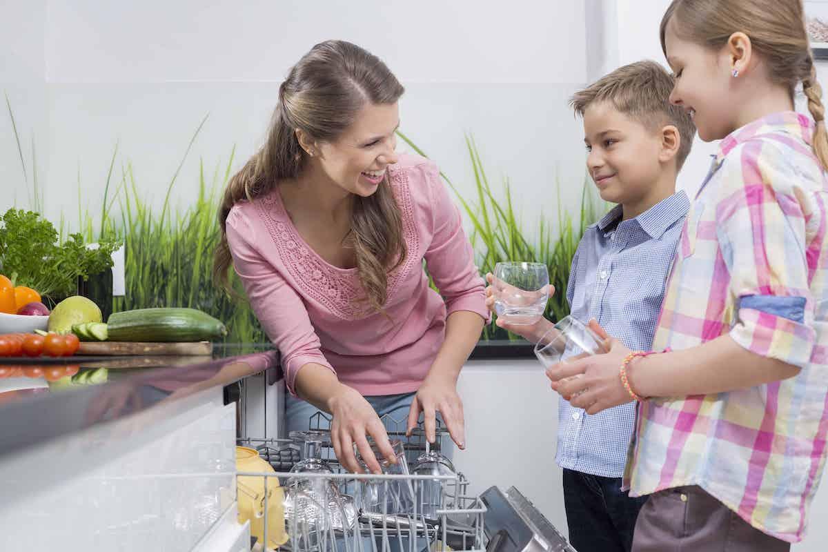 Family emptying dishwasher