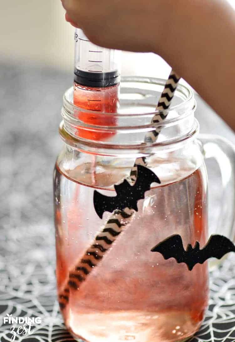 Using syringe for bloodshot halloween drink 23 spooktacular kid-friendly halloween mocktails