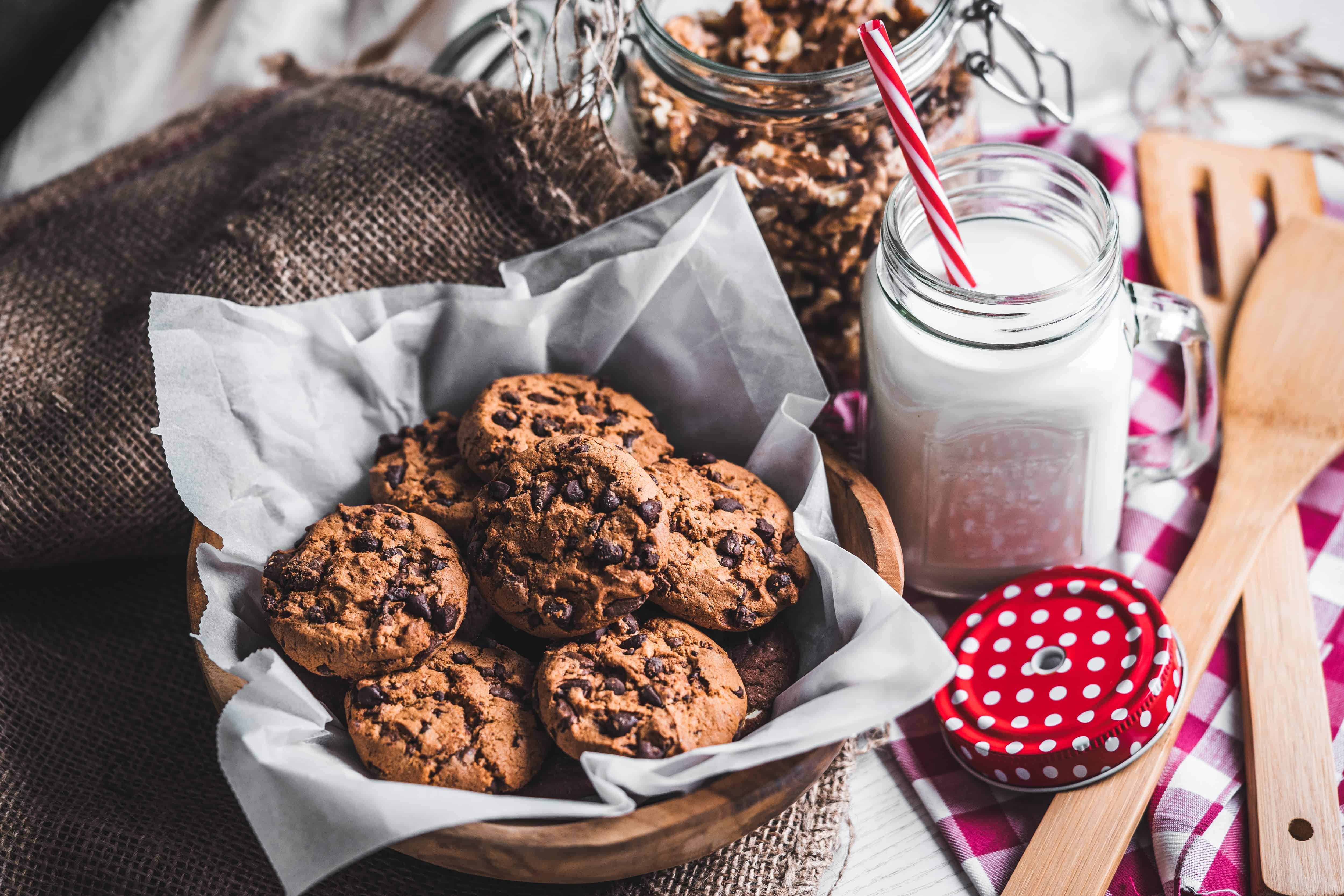 Baked cookies in basket with milk