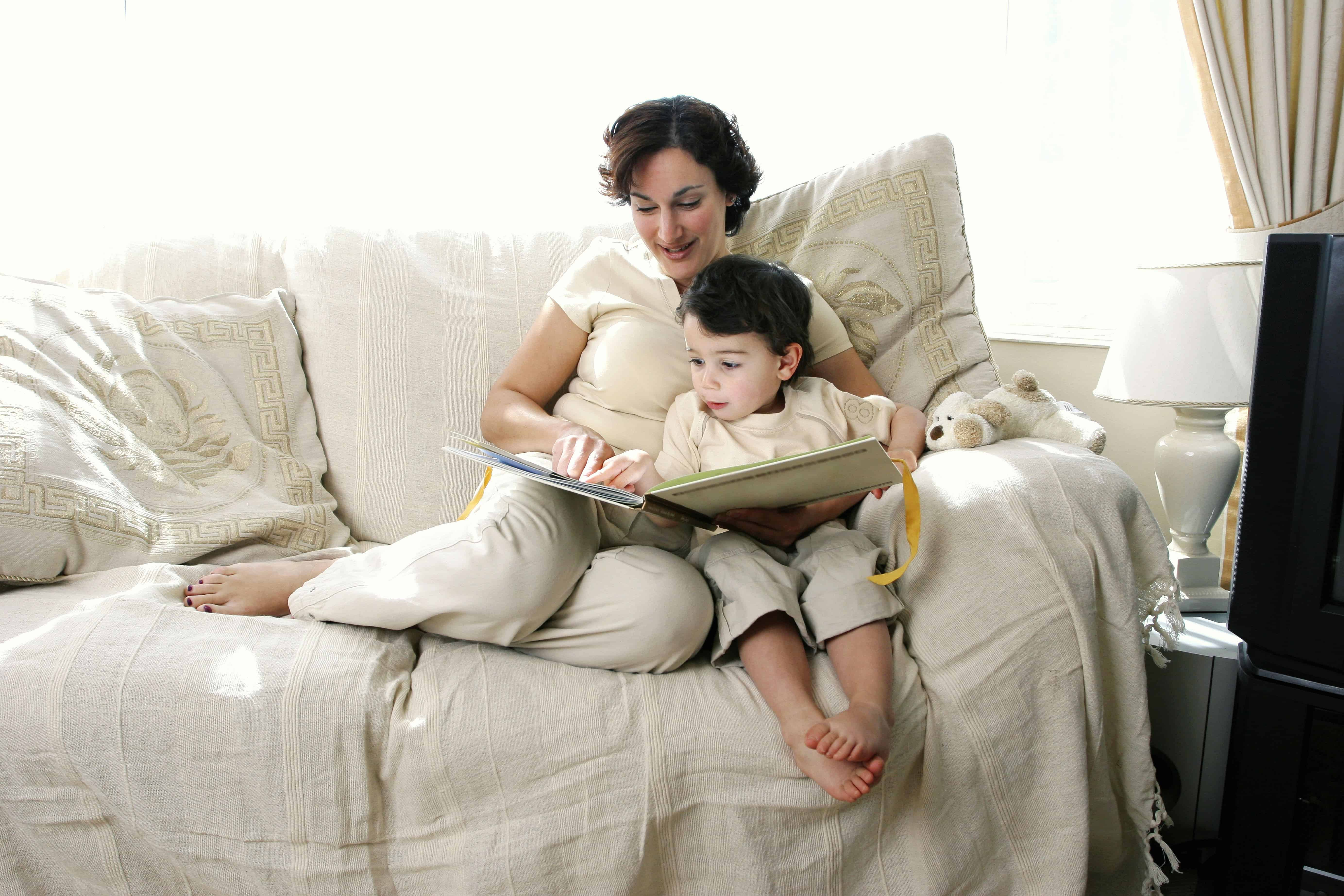 Child reading a book with mother - books make wonderful non-toy gift ideas for kids