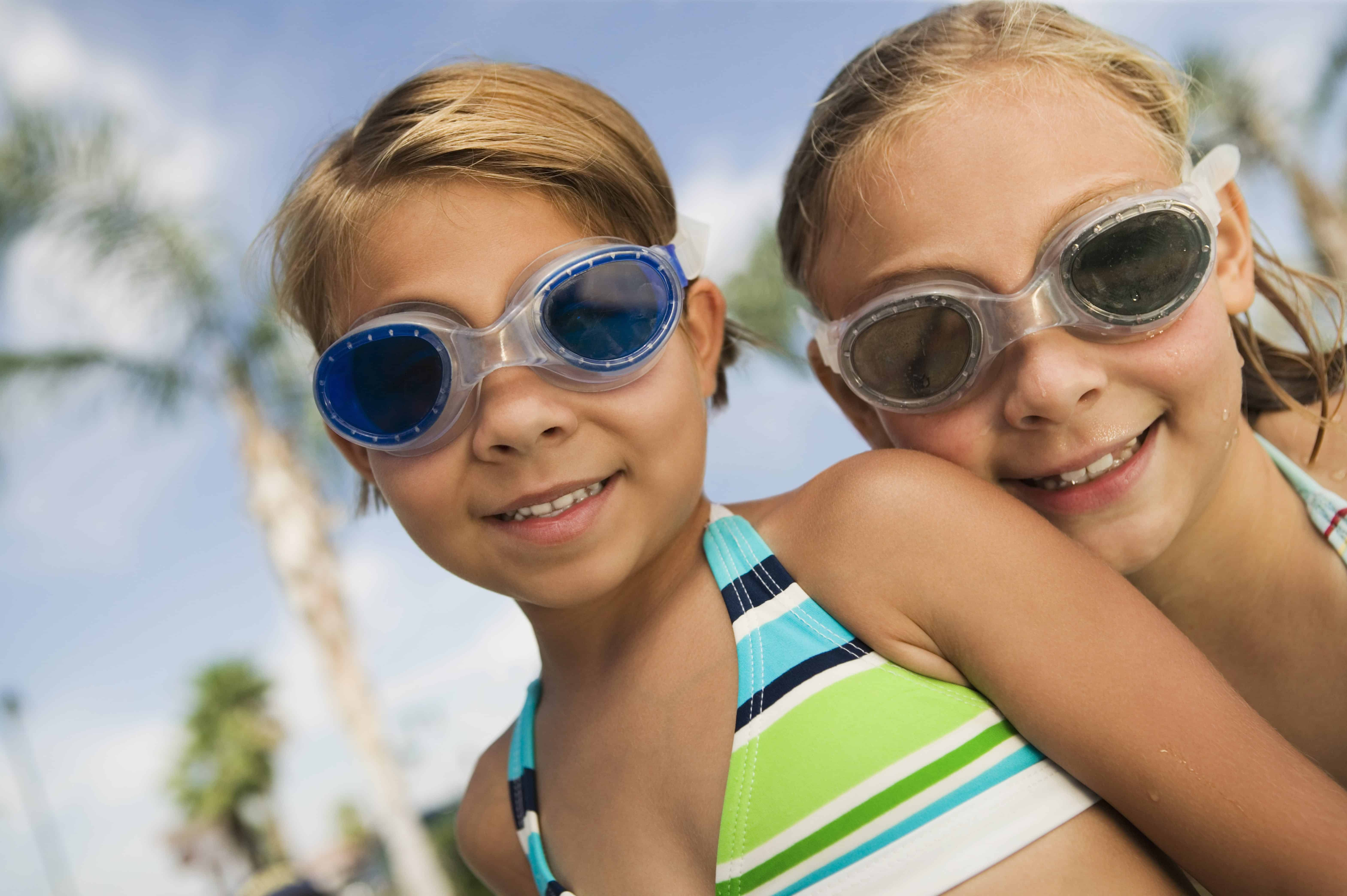 Two girls with googles at the pool