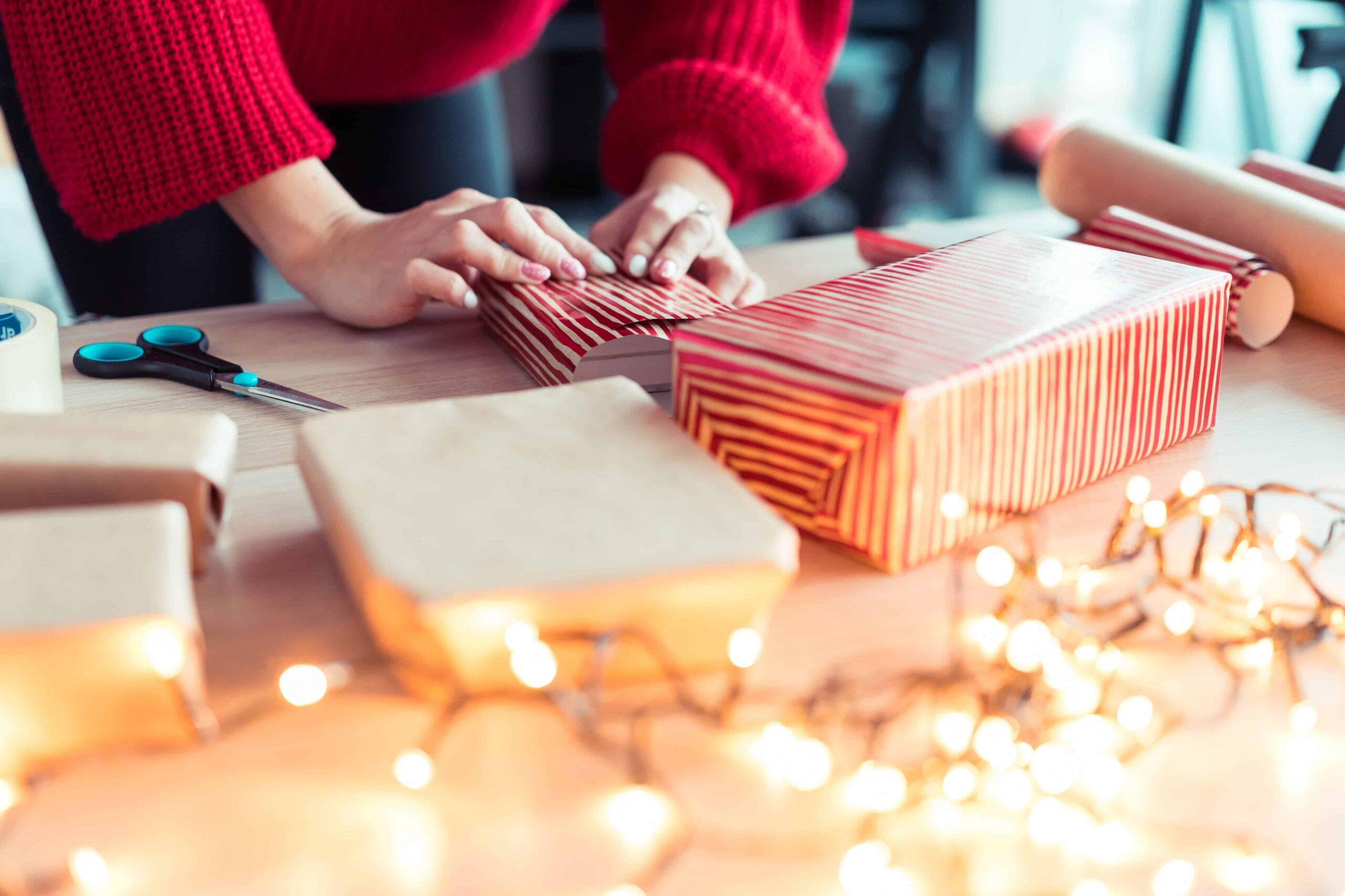 woman gift wrapping christmas presents