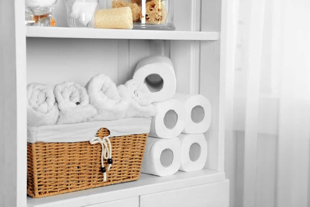 Linen closet organised with baskets