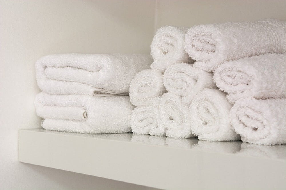 Rolled towels linen cupboard organisation ideas