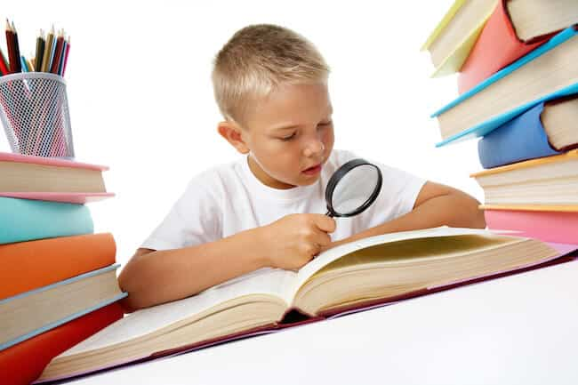 Child studying book copy