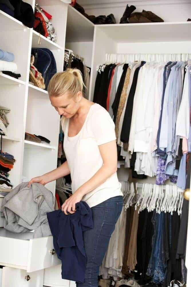 Woman decluttering wardrobe