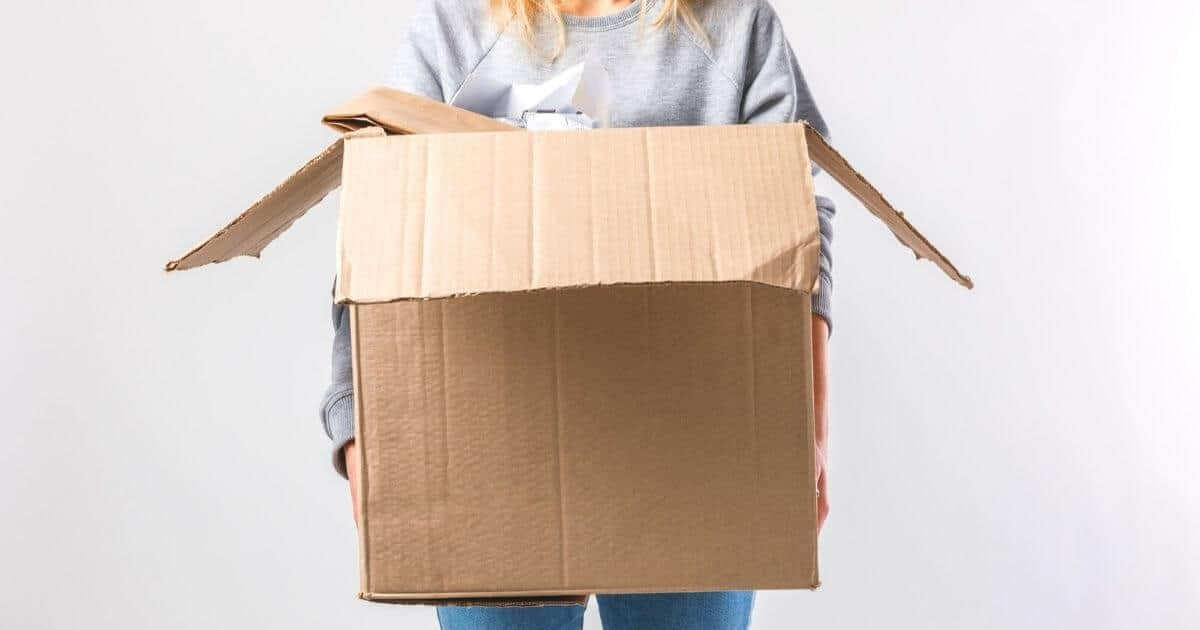 Lady with a cardboard box filled with unwanted clutter