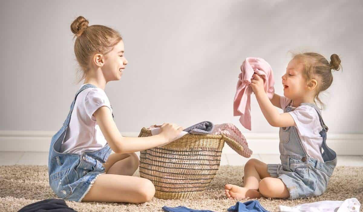 Kids folding laundry together