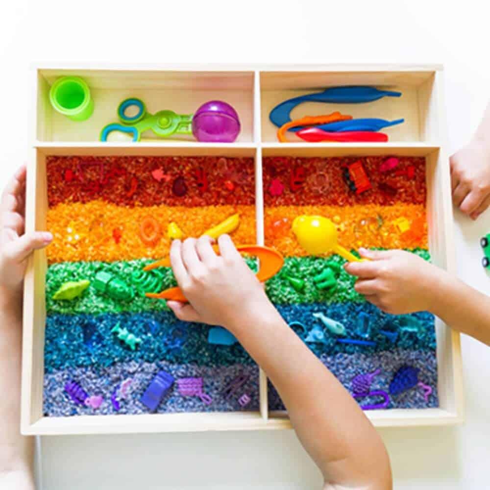 Rice sensory bin for toddler play