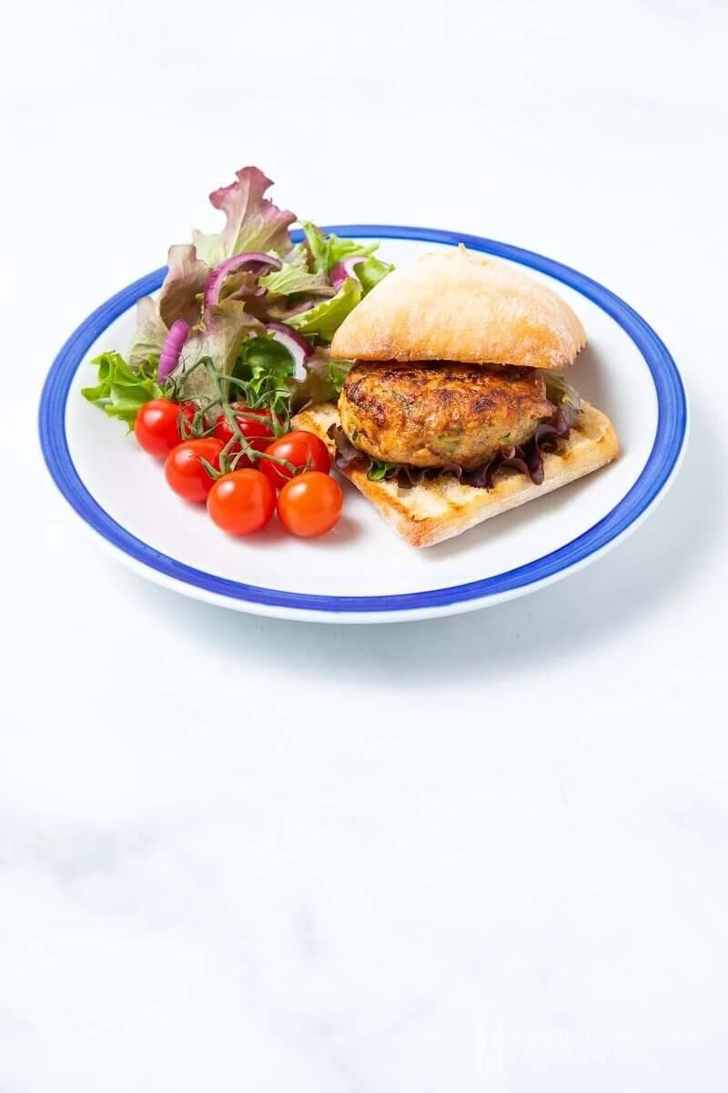 Chicken rissole on burger with salad