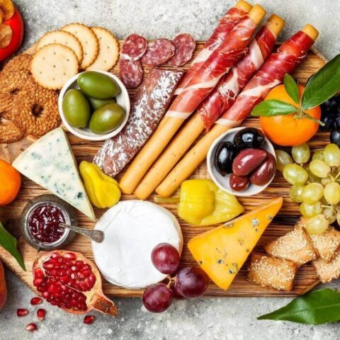 simple charcuterie board with cheese and fruit