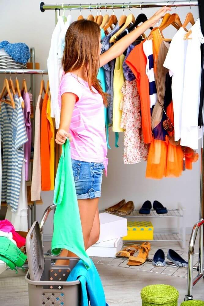 Woman declutterng wardrobe