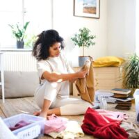 woman decluttering clothing