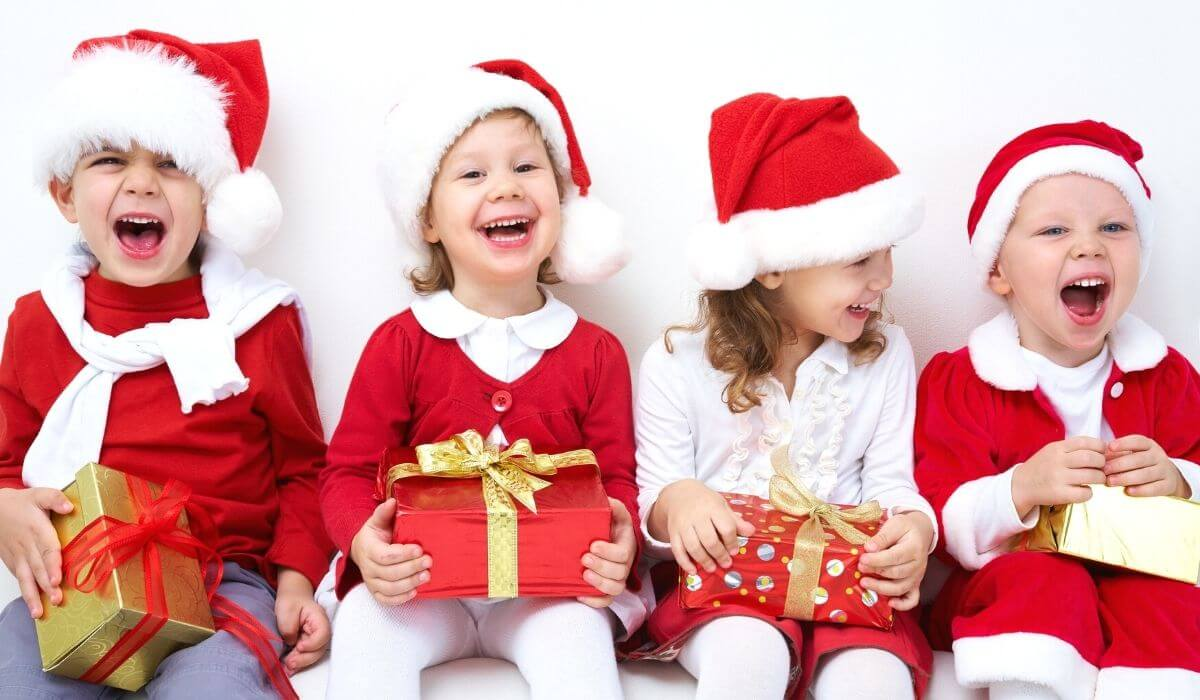 Kids laughing in christmas outfits